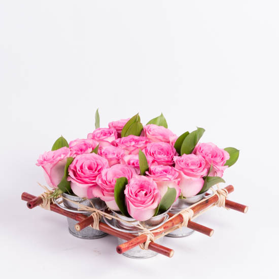 Pink roses in mini rose tin pails