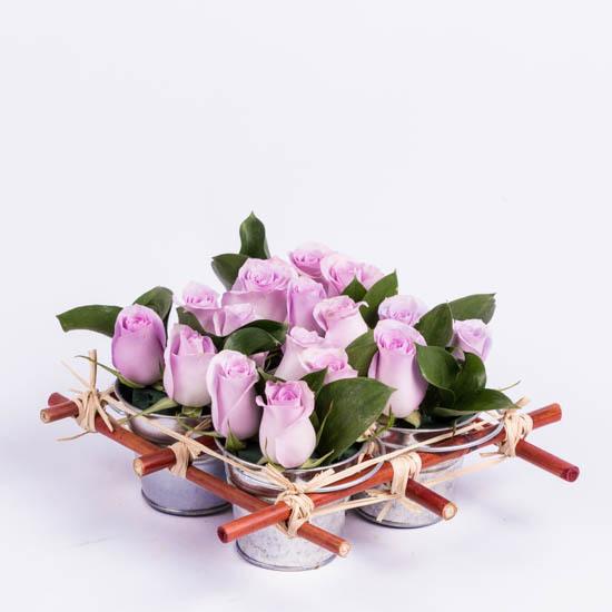 Purple roses in mini rose tin pails