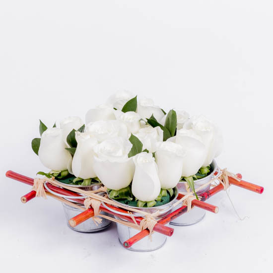 White roses in mini rose tin pails